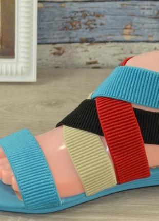Голубые босоножки с разноцветными резинками на ногах р.39