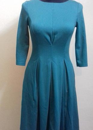 Платье со встречными складками