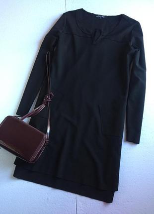 Чорна трикотажна сукня із кишенями
