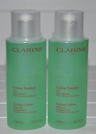 Тонизирующий лосьон clarins toning lotion with iris  объем 400мл