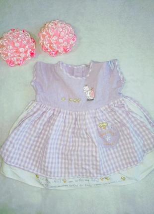 Платье в клеточку с вышивкой