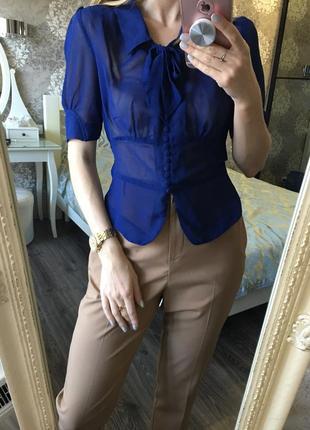 Блузка с бантом