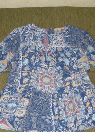 Стильная и интересная блуза расклешенная внизу next