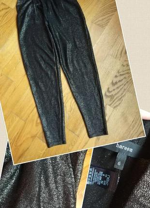 Фирменные качественные стильные штаны с люрексом .