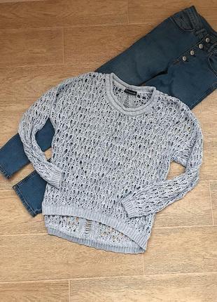 Женский оверсайз свитер нежно голубого цвета с люрексом открытый в дырках