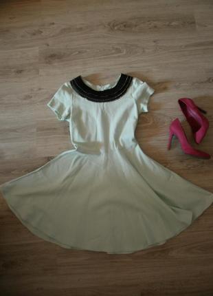 Стильне салатове плаття з воротнічком