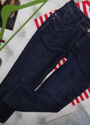 Уороченные джинсы