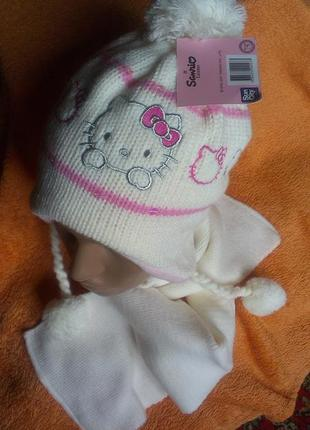 Теплый набор на девочку шапка и шарф.