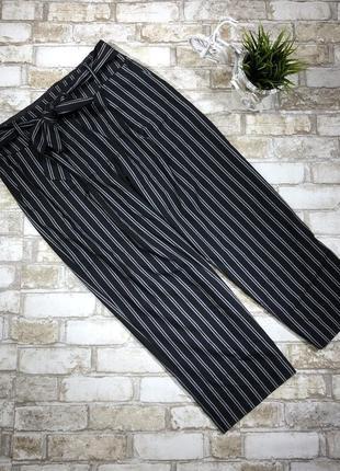 Актуальные трикотажные брюки кюлоты в полоску, полосатые свободные штаны с поясом5 фото