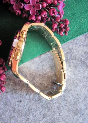 Красивые женские часы золото+изумруд geneva2