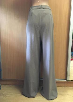 Шикарнейшие брюки палаццо с бантом карманами на высокий рост  размер 122 фото