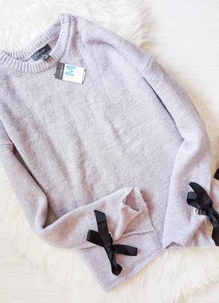 Шикарнейший свитер с бантами на рукавах primark