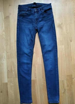 Темно-сині джинси