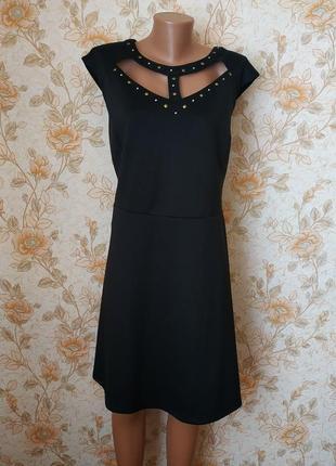 Шикарное,стиляжное платьице. на бирке-24 р-р(58)