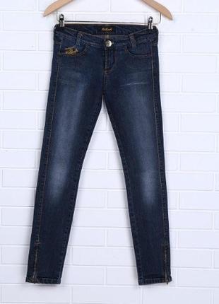 Стильные джинсы фирмы killah c замочками на внешних швах размер 28