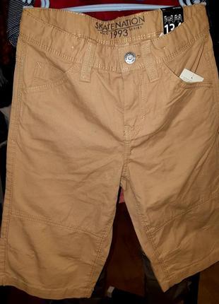 Фирменные шорты (134 см)