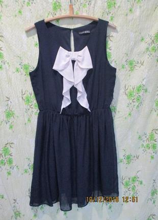 Красивое шифоновое платье с бантом на груди