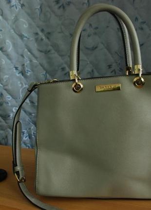 Шикарная  серая сумка с короткими и длинной ручкой carvela