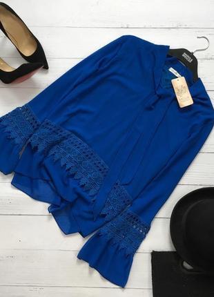 Новая шикарная блуза с ажурными вставками и воланами на рукавах