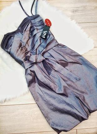 Елегантна вечірня сукня сріблястого кольору