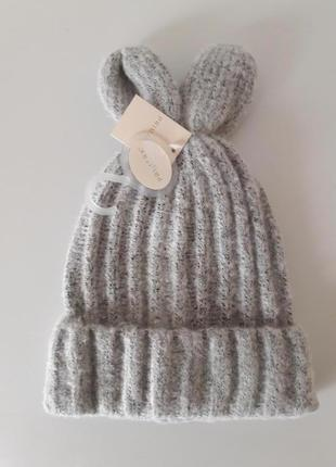 Теплая стильная шапочка