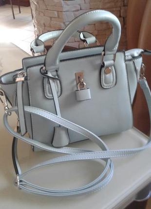 Невеличка сумка-саквояж бірюзового кольору