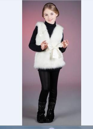 Белая меховая жилетка с мехом для вашей доченьки 8-9 лет бренд, очень красивая, 100 грн.
