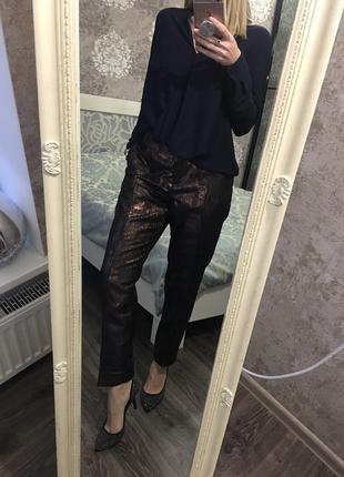 Блестящие брюки
