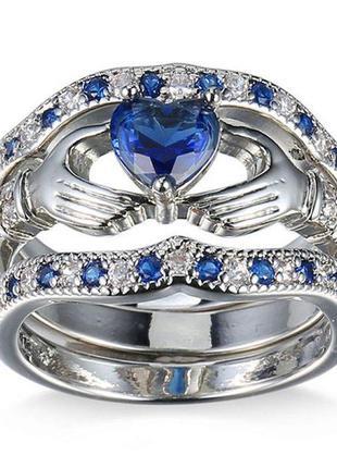 Набор колец 3 в 1 с голубыми кристаллами.