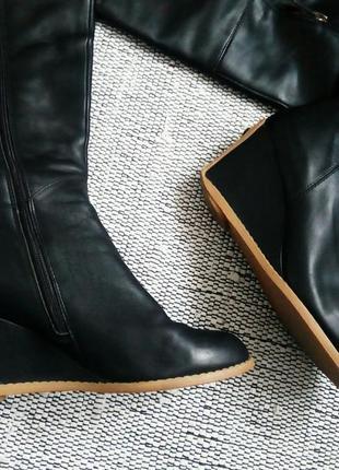 Кожаные сапоги высокий каблук финляндия