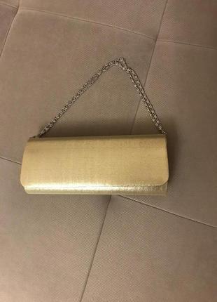 Золотистый клатч из парчи