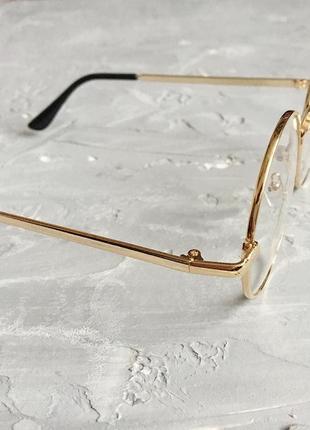 Круглые имиджевые очки с золотистой оправой5