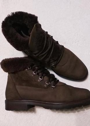 Зимові шкіряні ботінки на низькому каблуку italy lavorazione artigianale