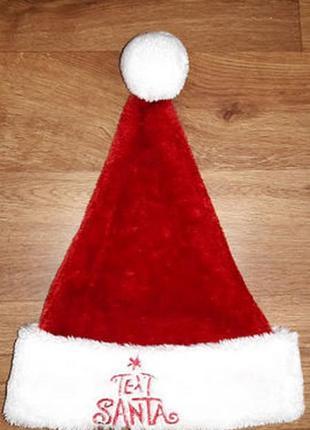Новогодняя шапка санта клаус text santa