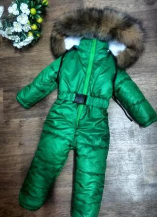 Цельный зеленый зимний комбинезон с натуральным мехом
