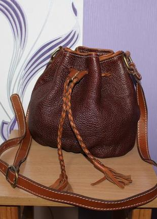 Шикарная кожаная сумка мешок с кисточками mephisto m