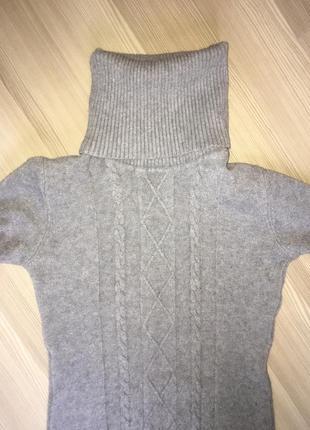 Удлиненный свитер в косы с шикарной горловиной