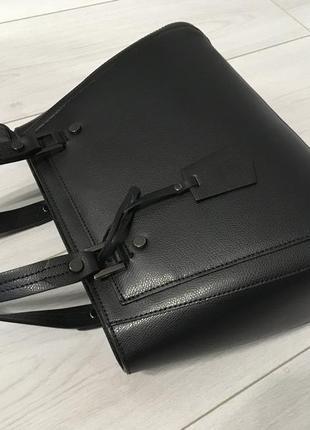 Компактная кожаная сумка из новой коллекции4 фото