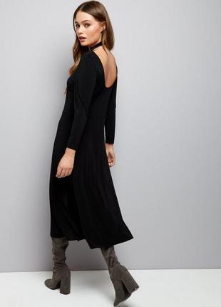Актуальное платье миди по фигуре, ткань масло, юбка свободная клёш с разрезом2 фото