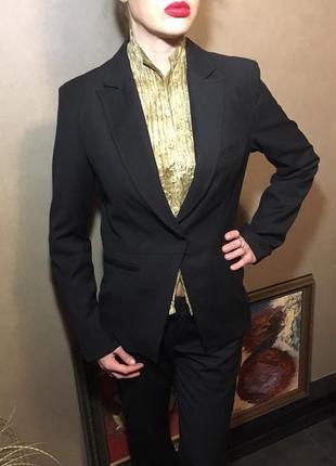 Новый брючный деловой костюм