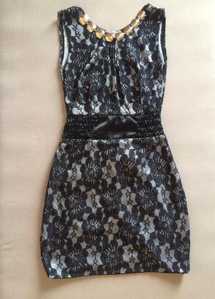Чорне приталенне плаття в мереживо гіпюр на короткий рукав trg