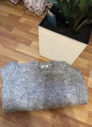 Теплый свитер косичка