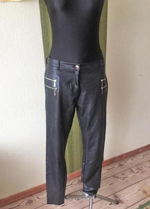 Фирменные кожаные брюки с карманами