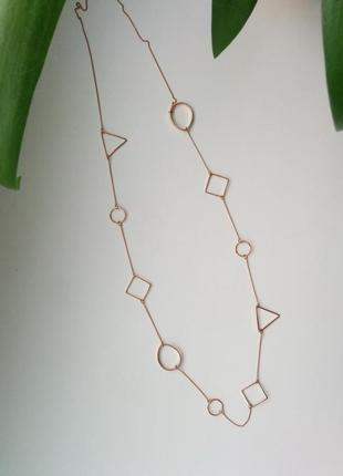Длинное колье с геометрическими кулонами цепочка