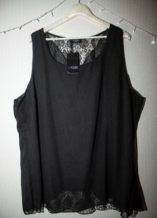Элегантная блузка без рукавов