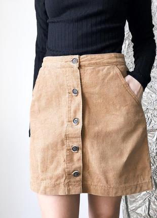 Вельветовые юбка с пуговицами  с карманами бежевого цвета