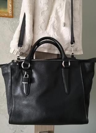 Роскошная стильная кожаная сумка.
