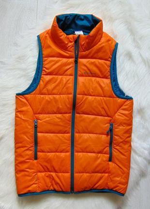 Quechua. размер 10 лет. яркая жилетка для парня