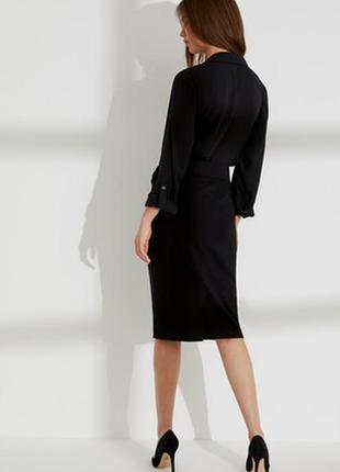 Изысканная силуэтная юбка миди с разрезом