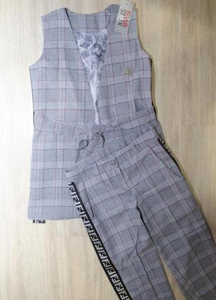 Стильний костюм, двійка: жилетка та штани з лампасами